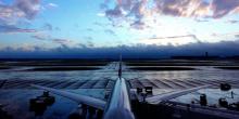 Cheap flights - plane on rainy runway in morning